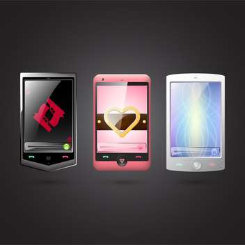 Set of vector cell phones on balck background - vector gratuit #131594