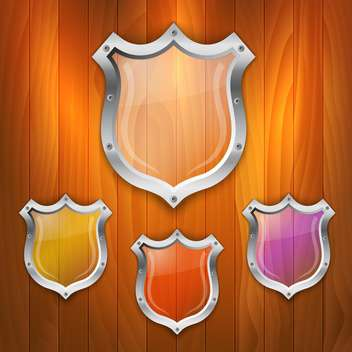 Vector set of glass shields on wooden background - Kostenloses vector #131694