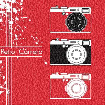 old retro camera set on red background - vector gratuit #127884
