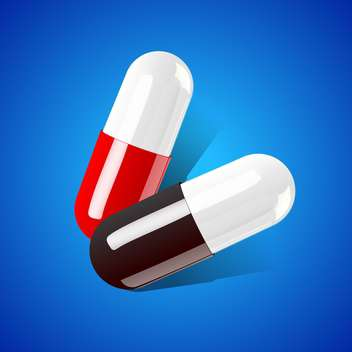 two medical tablets on blue background - vector gratuit #127904