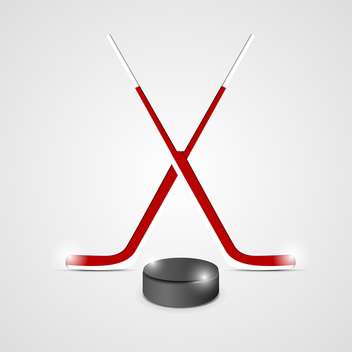 ice hockey sticks and puck - vector gratuit #132784