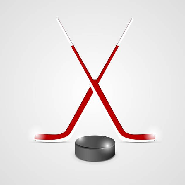 ice hockey sticks and puck - vector #132784 gratis